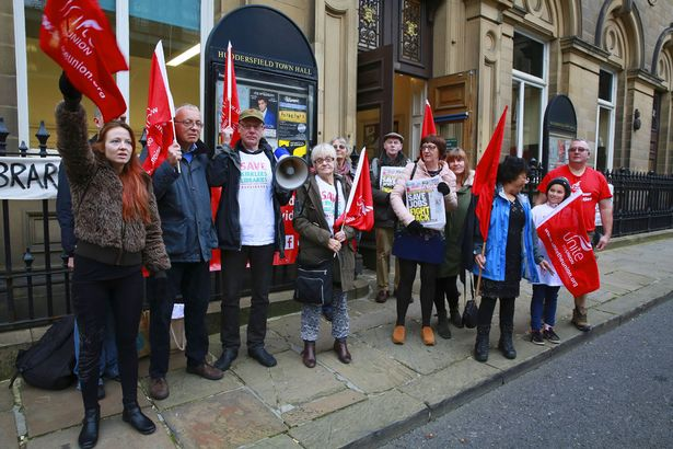 Unite and other unions protest outside Huddersfield Town Hall over the planned library cuts.