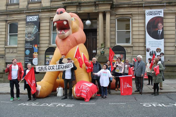 Campaigners against library cuts in Kirklees used a giant lion to get their message across outside Huddersfield Town Hall